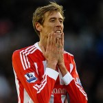STOKE ON TRENT, ENGLAND - JANUARY 21: Peter Crouch of Stoke City shows his frustrations during the Barclays Premier League match between Stoke City and West Bromwich Albion at Britannia Stadium on January 21, 2012 in Stoke on Trent, England.  (Photo by Laurence Griffiths/Getty Images)