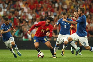 Spain's Isco gets the better of Italy's Lorenzo Insigne, left, Marco Verratti and Daniele De Rossi, right.